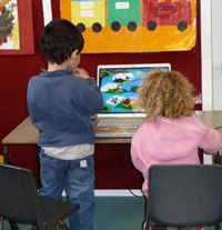 Two children at the computer